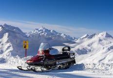 Snowmobile in the mountains Elbrus Stock Photo