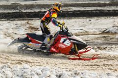 Snowmobile moves on bend of sport track Stock Photography