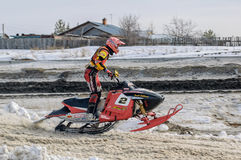 Snowmobile moves on bend of sport track Stock Photo