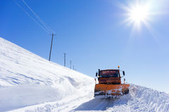 Snowmobile moving snow to clear the roads in Falakro ski center, Stock Image