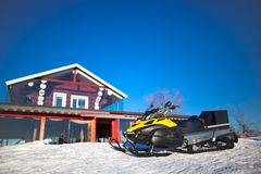 Snowmobile, near a beautiful home Stock Image