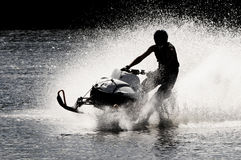 Snowmobile on open water Royalty Free Stock Image