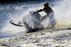 Snowmobile on open water Stock Photos