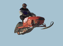 Snowmobile racer in air Stock Photos
