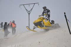 Snowmobile racer sprints on the way down Royalty Free Stock Images
