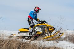 Snowmobile rider on sport track Royalty Free Stock Photos