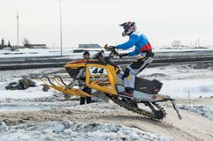 Snowmobile rider on sport track Stock Photography
