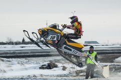 Snowmobile rider on sport track Stock Photo