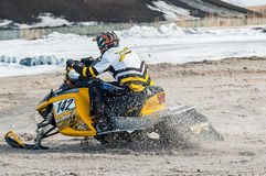 Snowmobile rider on sport track Royalty Free Stock Images