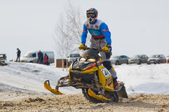 Snowmobile rider on sport track Stock Image