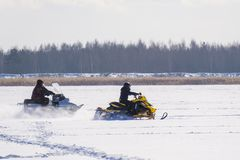 Snowmobile on the river stock image