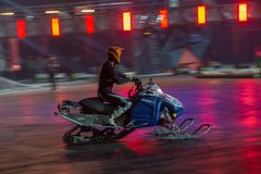 On a snowmobile. RUSSIA, MOSCOW - APRIL 1, 2017: Flying on the snowmobile Athletes in the discipline SFX at the 10 festival of extreme sports in the Olympic Royalty Free Stock Images