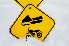 Signs on a snowmobile trail in Laval stock photos