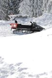 Snowmobile in snow Stock Images