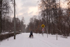 Snowmobile on snow-covered road Royalty Free Stock Photos