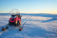 Snowmobile in a snowy landscape in Lapland near Saariselka, Finland. Snowmobile in a snowy landscape in Lapland, near Saariselka, Finland Royalty Free Stock Image