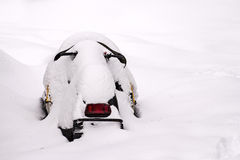 Snowmobile stuck in snow Stock Images