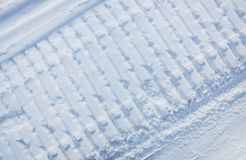 Snowmobile trace on snow. Snowmobile traces on white snow Royalty Free Stock Image