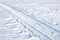 Snowmobile traces on snow. Stock Images
