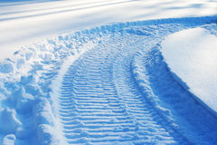 Snowmobile track on snow Stock Photo
