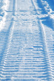 Snowmobile track on snow Stock Images