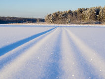 Snowmobile track. In snow landscape Stock Photos