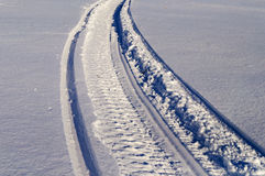 Snowmobile track in snow Stock Image
