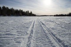 Snowmobile Tracks on Frozen Lake Royalty Free Stock Image
