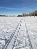 Snowmobile Tracks on Frozen Lake Royalty Free Stock Photo