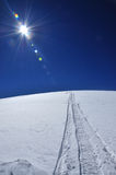 Snowmobile tracks in the snow. On Sureanu mountains, Romania Stock Photography