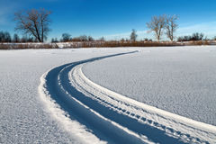 The snowmobile tracks Royalty Free Stock Photos