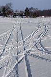 Snowmobile Tracks in Snow During Winter Royalty Free Stock Photos