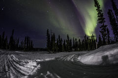 Snowmobile trail+northen light Stock Photography