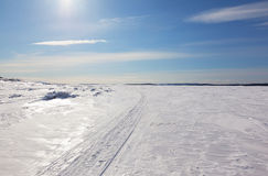 Snowmobile trail stretching into the distance to the horizon Stock Photos