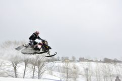 Snowmobile unidentified rider airborne Stock Photography