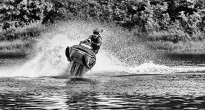 Snowmobile on water Stock Photography