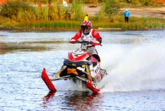 Snowmobile watercross Stock Images