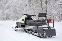 Snowmobile at the winter forest Stock Photo