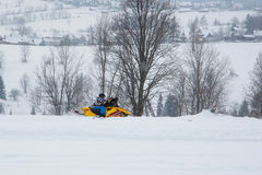 Snowmobile in winter scenery Royalty Free Stock Image