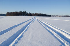 Snowmobile winter transport marks frozen lake snow Stock Photos