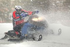 Snowmobiler. In some white fluffy snow Stock Photography