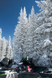 Snowmobiler break on sunny day Royalty Free Stock Photos