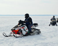 Snowmobilers on Lake Stock Photo