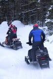 Snowmobilers ritt på en slinga på Bald berget, Rangeley, Maine Arkivfoto