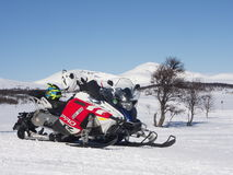 Snowmobiles. BRUKSVALLARNA, SWEDEN - APRIL 18 2017 [Parked snowmobiles with Skarsmountain in the background Stock Images