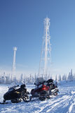 Snowmobiles and communication equipment in forest Stock Photos