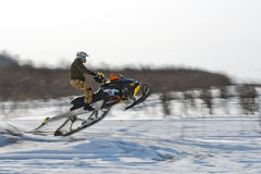Snowmobiles in the competition winter sprint 2014 Royalty Free Stock Photo