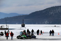 Snowmobiles and helicopter rides on Lake George,during Winterfest,Lake George New York,February 2nd, 2014 Royalty Free Stock Photo