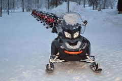 Snowmobiles lined up for an excursion Stock Photography