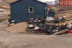 Snowmobiles parked on wooden pallets in the summer in Longyearbyen. Svalbard, Norway stock images